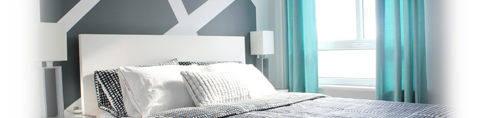 White headboard, crystal lamp, silk curtains, graphic pillows
